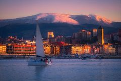 Getxo village with a sailboat. In winter stock images
