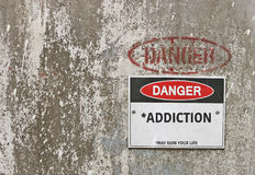 Gevaar, Verslavingswaarschuwingsbord Stock Foto