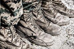 Gevechtslaarzen in de woestijn Stock Foto