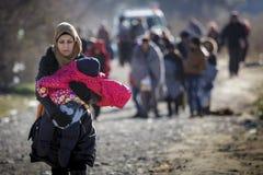 Gevgeljia macedonian border. Macedonia - FYROM - Gevgeljia. Refugees after cross the greek border walking to reach the refugee transit camp stock image
