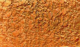 Gevlekte oranje gouden geweven achtergrond Royalty-vrije Stock Afbeeldingen
