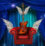 Gevleugelde stoel en gitaar Stock Fotografie