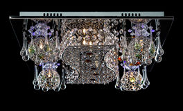 Gevoelige die kroonluchter van de lampen van de kleurenbloem op zwarte worden geïsoleerd Royalty-vrije Stock Foto