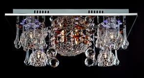 Gevoelige die kroonluchter van de lampen van de kleurenbloem op zwarte worden geïsoleerd Royalty-vrije Stock Foto's