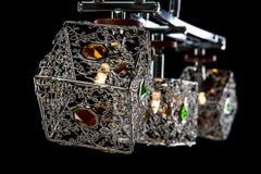 Gevoelige die kroonluchter van kleurenlampen op zwarte, close-up worden geïsoleerd Royalty-vrije Stock Afbeeldingen
