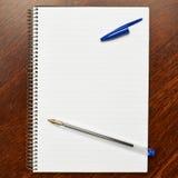 Gevoerd notaboek over de lijst Royalty-vrije Stock Foto