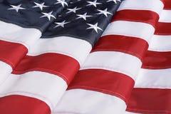 Gevouwen Amerikaanse vlag als achtergrond, close-up Nationaal symbool royalty-vrije stock fotografie