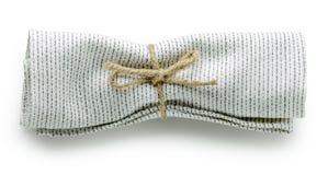 Gevouwen katoenen servet stock afbeelding