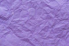 Gevouwen purpere document textuurachtergrond Stock Foto's