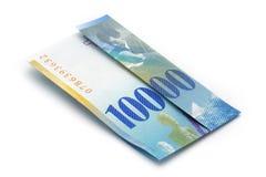 Gevouwen 100 van kaartjeschf (10 ' 000 CHF) Royalty-vrije Stock Foto's