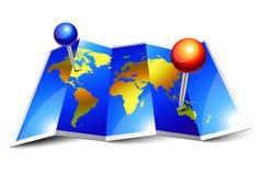 Gevouwen wereldkaart en spelden Stock Afbeelding
