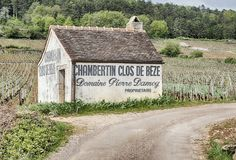 Cos De Beze Barn In Vineyard. GEVREY-CHAMBERTIN, FRANCE - APRIL 23, 2018: A small barn or farm outbuilding is located by the side of the road in the Clos de Beze Royalty Free Stock Images