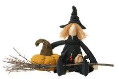 Gevuld heksenstuk speelgoed met bezem en pompoen Stock Afbeelding