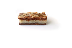 Gevulde speculaas (brown spiced biscuit) on white Stock Images
