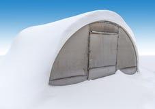 Gewächshaus im Schnee Lizenzfreie Stockfotos