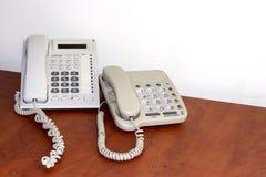 Gewöhnliches Bürotelefon Stockfotos