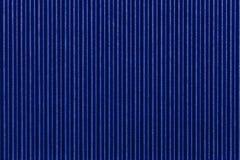 Gewölbtes blaue Papier der Beschaffenheit Gestreifter Hintergrund Stockfoto