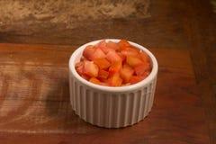 Gewürfelte Tomaten in einer Schüssel Lizenzfreies Stockbild