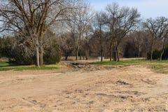 Gewaschene heraus Straße zu Tooley-Park durch den Platte River stockbilder