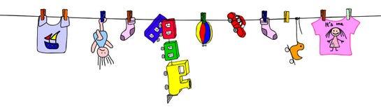 Gewassen speelgoed dat op kabel drogen   Stock Foto's