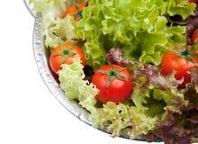 Gewassen verse tomaten met salade Stock Foto