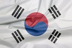 Gewebe-Flagge von Südkorea Falte des südkoreanischen Flaggenhintergrundes lizenzfreie stockbilder