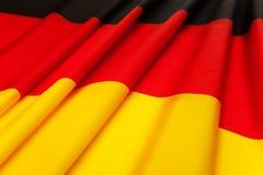 Gewebe gefaltete deutsche Flagge, die auf Flachheit legt Lizenzfreie Stockfotos