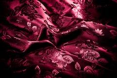 Gewebe, Hintergrundbeschaffenheit silk rotes Gewebe mit einem Muster von Florida Stockfoto