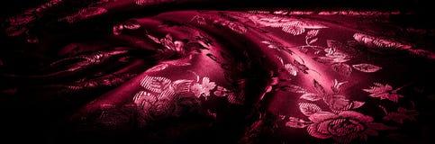 Gewebe, Hintergrundbeschaffenheit silk rotes Gewebe mit einem Muster von Florida Stockbild