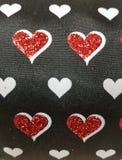 Gewebe mit Design von Zahlen von Herzen, strukturierter Hintergrund stockfotos