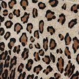 Gewebe mit einem Muster in Form von Leopardhäuten Stockfotografie