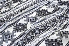Gewebe mit einem schwarzen Muster stockbilder