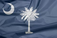 Gewebeflagge von South Carolina Falte des South- Carolinaflaggenhintergrundes stockfoto