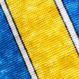 Gewebemuster mit Blauem und Gelbem lizenzfreie stockfotos