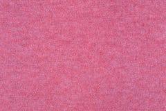 Gewebestrickgarnbeschaffenheits-Rosafarbe Stoff gestrickter Wollhintergrund Lizenzfreie Stockbilder