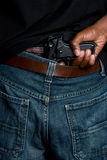 Gewehr in den Hosen lizenzfreie stockbilder