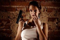 Gewehr in den Tätigkeiten Lizenzfreie Stockfotografie