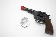 Gewehr und Abzeichen Lizenzfreie Stockfotografie