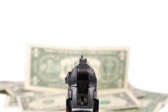 Gewehr und Geld Stockfoto