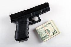 Gewehr und Geld lizenzfreies stockbild