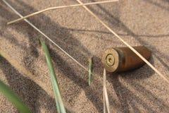 Gewehrkugel im Sand 2 Lizenzfreies Stockfoto