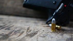 Gewehrkugeln und Gewehr Stockfotos
