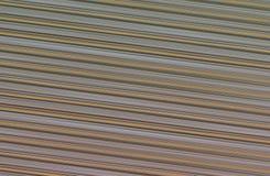 Gewellte Beige der abstrakten metallischen Hintergrundseitenlinie-Beschaffenheit Stockfotografie