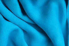 Gewellte Falten des blauen Hintergrundzusammenfassungs-Stoffes der Textilbeschaffenheit Stockfotos
