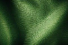 Gewellte Falten des grünen Hintergrundzusammenfassungs-Stoffes der Textilbeschaffenheit lizenzfreies stockfoto
