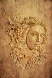 Geweven Achtergrond van de blakerstandbeeld van de Druiven haired Grieks vrouw Stock Foto's