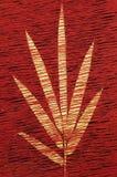 Geweven blad op rode achtergrond Stock Foto's