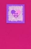 Geweven hart op een roze achtergrond Royalty-vrije Stock Foto's