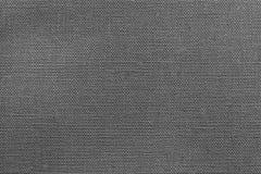 Geweven ruwe stof als achtergrond van donkergrijze kleur Royalty-vrije Stock Fotografie