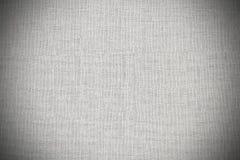 Geweven witte afwijkingsachtergrond met vignet Stock Fotografie
